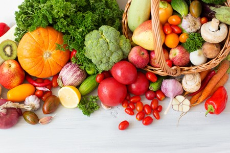 Collection fruits and vegetables isolated top view.